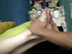 father and step-daughter have enjoyment with feet