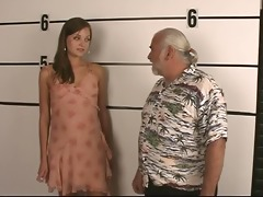 arrested youthful brunette strips for old fellow